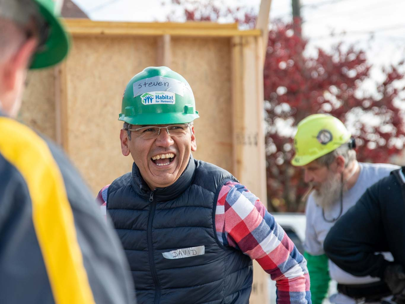 Construction volunteer smiling on the build site